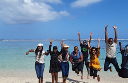 Students jumping at the beach ACU Summer School 2019 Mauritius