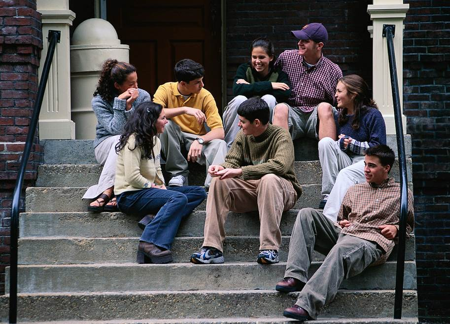 Group of young people talking on stairs