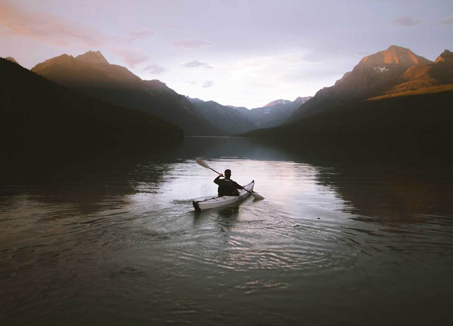 Man paddling canoe on a lake - Image by Nathan Peterson on Unsplash (RESIZED)