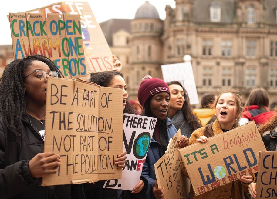 Young climate protestors with signs